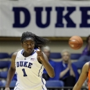 FILE - In this Nov. 18, 2011, photo, Duke's Elizabeth Williams points following a basket against Auburn during an NCAA college basketball game in Durham, N.C. Duke is led by a pair of preseason all-Atlantic Coast Conference picks in junior guard Chelsea Gray and sophomore forward Williams. (AP Photo/Gerry Broome, File)