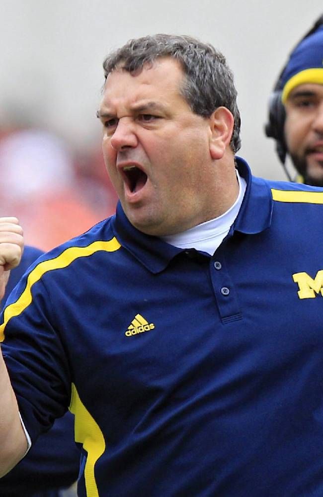In this Nov. 24, 2012 file photo, Michigan head coach Brady Hoke yells at his team in an NCAA college football game against Ohio State in Columbus, Ohio. It has already been a successful season for No. 3 Ohio State, but as the Buckeyes know, no season is a success if they lose to their chief rivals, the Michigan Wolverines