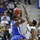 Memphis guard Joe Jackson (1) is forced to pass the ball against the defense from Michigan State guard Keith Appling (11) in the first half of a third-round game of the NCAA college basketball tournament Saturday, March 23, 2013, in Auburn Hills, Mich. (AP Photo/Duane Burleson)
