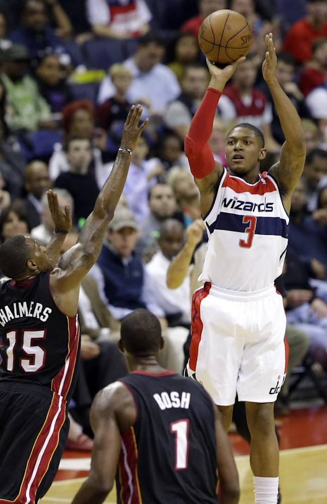 Washington Wizards guard Bradley Beal (3) shoots over Miami Heat guard Mario Chalmers (15) in the second half of a preseason NBA basketball game Tuesday, Oct. 15, 2013, in Washington. Beal had 29 points as the Wizards won 100-82