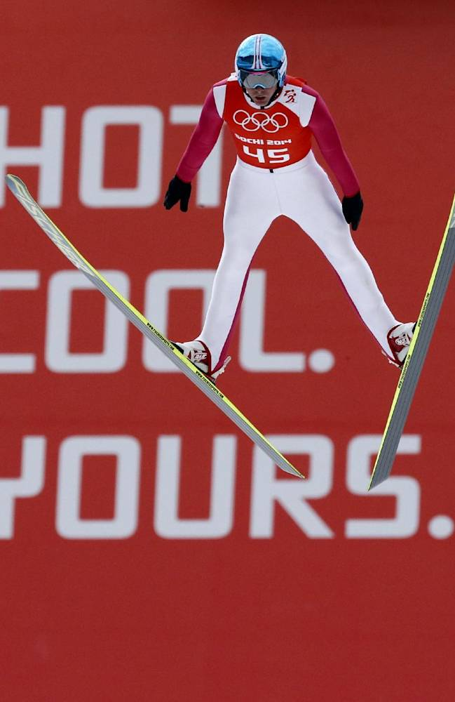 Norway's Joergen Graabak soars through the air during a men's nordic combined training session at the 2014 Winter Olympics, Tuesday, Feb. 11, 2014, in Krasnaya Polyana, Russia
