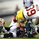 Philadelphia Eagles tight end Zach Ertz (86) is tackled by Washington Redskins cornerback Josh Wilson, left, and free safety David Amerson (39) during the first half of an NFL football game in Philadelphia, Sunday, Nov. 17, 2013 The Associated Press