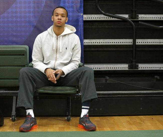 Shabazz Napier from Connecticut watches the 2014 NBA basketball Draft Combine Thursday, May 15, 2014, in Chicago. Napier did not participate in his scheduled first group
