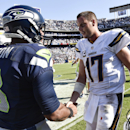 San Diego Chargers quarterback Philip Rivers (17), right, shakes hands with Seattle Seahawks quarterback Russell Wilson (3) after the Chargers defeated the Seahawks 30-21 in an NFL football game Sunday, Sept. 14, 2014, in San Diego The Associated Press