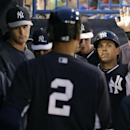 New York Yankees congratulate Brian Roberts after he scored on Derek Jeter's second-inning ground out in a spring exhibition baseball game against the Pittsburgh Pirates in Tampa, Fla., Friday, March 21, 2014 The Associated Press