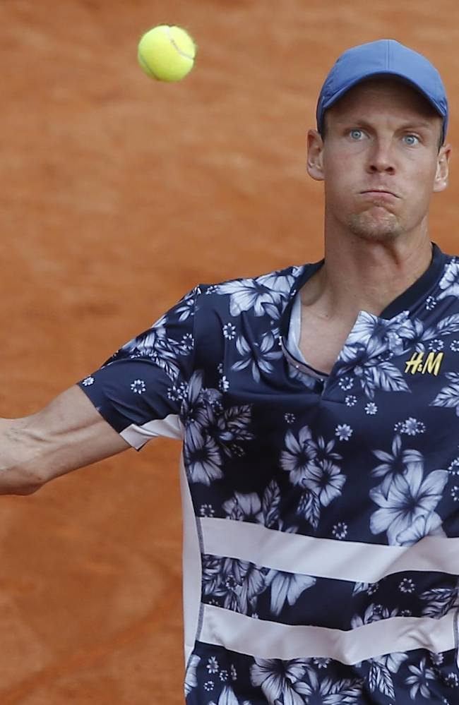 Tomas Berdych of the Czech Republic returns the ball during the first round match of the French Open tennis tournament against Canada's Peter Polansky at the Roland Garros stadium, in Paris, France, Sunday, May 25, 2014