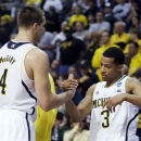 Michigan forward Mitch McGary (4) celebrates with guard Trey Burke (3) after their 78-53 win over Virginia Commonwealth in a third-round game of the NCAA college basketball tournament, Saturday, March 23, 2013, in Auburn Hills, Mich. (AP Photo/Duane Burleson)