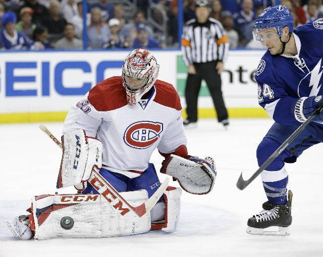 Montreal Canadiens goalie Carey Price (31) makes a save on a shot by Tampa Bay Lightning right wing Ryan Callahan (24) during the second period of Game 1 of a first-round NHL hockey playoff series on Wednesday, April 16, 2014, in Tampa, Fla