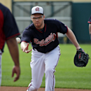 Atlanta Braves first baseman Freddie Freeman tosses the ball to first base during a spring training baseball workout, Monday, Feb. 24, 2014, in Kissimmee, Fla The Associated Press