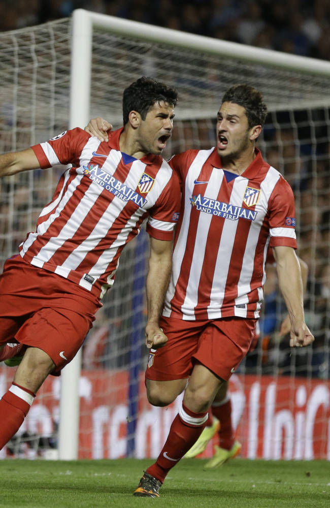 Atletico's Diego Costa, left celebrates with Koke after he scored a penalty during the Champions League semifinal second leg soccer match between Chelsea and Atletico Madrid at Stamford Bridge Stadium in London Wednesday, April 30, 2014. (AP Photo/Kirsty Wigglesworth)