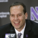 Chris Collins, Northwestern University's new head basketball coach, responds to a question during a news conferenceTuesday, April 2, 2013 in Evanston, Ill. (AP Photo/Charles Rex Arbogast)