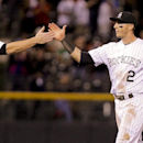 Colorado Rockies' DJ LeMahieu (9) and Troy Tulowitzki (2) high-five after beating the San Francisco Giants 2-1 in a baseball game, Tuesday, April 22, 2014, in Denver The Associated Press