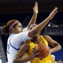 UCLA forward Alyssia Brewer, left, defends California forward Reshanda Gray during the first half of an NCAA college basketball game in Los Angeles, Friday, Feb. 15, 2013. (AP Photo/Jae C. Hong)