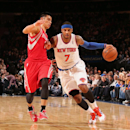 NEW YORK, NY - NOVEMBER 14: Carmelo Anthony #7 of the New York Knicks drives against Jeremy Lin #7 of the Houston Rockets during a game at Madison Square Garden in New York City on November 14, 2013. (Photo by Nathaniel S. Butler/NBAE via Getty Images)