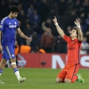 FILE - In this Wednesday, March 11, 2015 file photo PSG's David Luiz, right, celebrates at the final whistle as Chelsea's Diego Costa leaves the field after the Champions League round of 16 second leg soccer match between Chelsea and Paris Saint Germain a