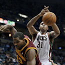 Milwaukee Bucks' John Henson (31) and Cleveland Cavaliers' Tristan Thompson (13) go after a rebound during the second half of an NBA basketball game Wednesday, Nov. 6, 2013, in Milwaukee The Associated Press