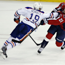 Washington Capitals center Brooks Laich (21) shoots the puck as he is defended by Edmonton Oilers defenseman Justin Schultz (19) in the third period of an NHL hockey game, Tuesday, Jan. 20, 2015, in Washington. Edmonton won 5-4 in a shootout The Associate
