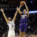 Phoenix Suns' Gerald Green (14) attempts but misses a buzzer shot as San Antonio Spurs' Marco Belinelli (3), of Italy, defends him during the second half of an NBA basketball game Wednesday, Nov. 6, 2013, in San Antonio. San Antonio won 99-96 The Associat