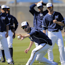 Milwaukee Brewers outfielder Ryan Braun makes a bare hand catch during spring training baseball practice, Monday, Feb. 24, 2014, in Phoenix The Associated Press