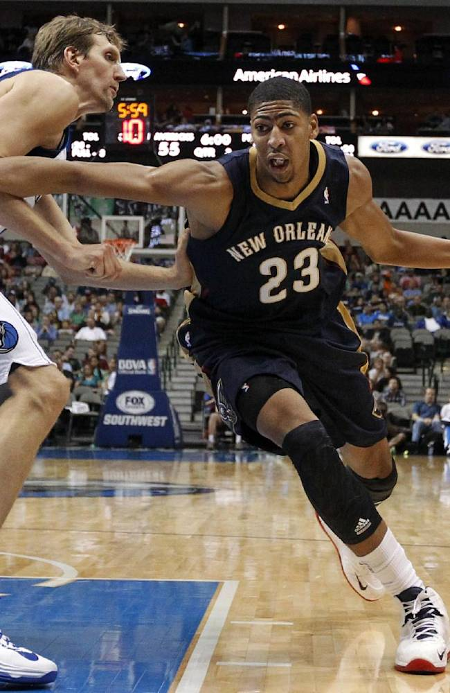 Dallas Mavericks' Dirk Nowitzki, of Germany, left, defends causing New Orleans Pelicans forward Anthony Davis (23) to lose control of the ball trying to get to the basket in the second half of a preseason NBA basketball game, Monday, Oct. 7, 2013, in Dallas