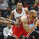 Chicago Bulls power forward Carlos Boozer (5) is defended by Atlanta Hawks' Elton Brand, left, and Mike Scott, in the first half of an NBA basketball game Tuesday, Feb. 25, 2014, in Atlanta The Associated Press