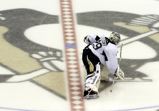 Pittsburgh Penguins goalie Marc-Andre Fleury (29) skates over the team logo at center ice before the start of a scrimmage on the first day on the ice at the NHL hockey training camp practice on Thursday, Sept. 12, 2013 in Pittsburgh