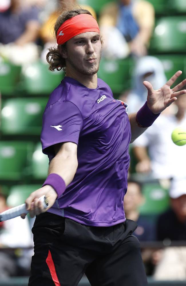 Lukas Lacko of Slovakia returns a shot against Edouard Roger-Vasselin of France during their second round match at the Japan Open Tennis Championships in Tokyo, Thursday, Oct. 3, 2013