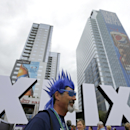Steve Bronson, from Tempe, Ariz., walks past Roman numerals for the NFL Super Bowl XLIX, Thursday, Jan. 29, 2015, in downtown Phoenix. The New England Patriots face the Seattle Seahawks in Super Bowl XLIX on Sunday in Glendale, Ariz The Associated Press