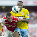 Arsenal's Mathieu Debuchy, left, fights for the ball with Crystal Palace's Yannick Bolasie, during their English Premier League soccer match, at Emirates Stadium, in London, Saturday, Aug. 16, 2014