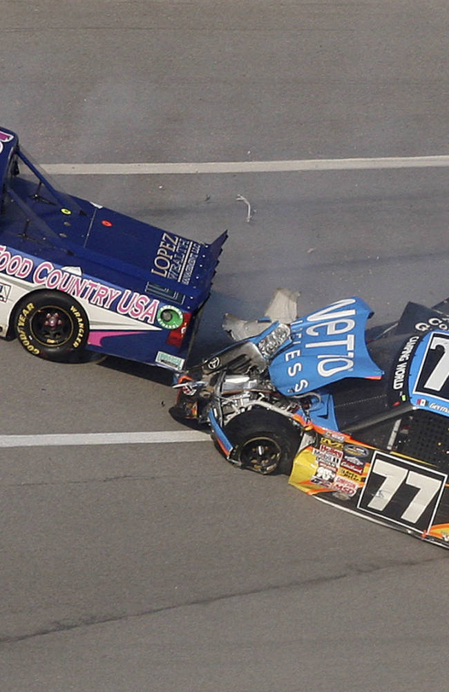 Caleb Holman (75), German Quiroga (77) and Chris Cockrum (07) collide in Turn 3 during the NASCAR Camping World Truck Series race at the Talladega Superspeedway in Talladega, Ala., Saturday, Oct. 19, 2013