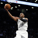 Brooklyn Nets shooting guard Marcus Thornton (10) scores on a breakaway layup in the first half of an NBA basketball game against the Memphis Grizzlies on Wednesday, March 5, 2014, in New York The Associated Press