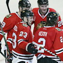 Chicago Blackhawks right wing Kris Versteeg (23) celebrates with teammates after scoring a goal against the San Jose Sharks during the third period of an NHL hockey game on Sunday, Nov. 17, 2013, in Chicago The Associated Press