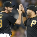Pittsburgh Pirates relief pitcher Jason Grilli (39) and third baseman Pedro Alvarez celebrate after the Pirates defeated the Milwaukee Brewers 2-1 in a baseball game Saturday, June 29, 2013, in Pittsburgh. (AP Photo/Keith Srakocic)