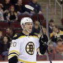 Boston Bruins left wing Daniel Paille celebrates after scoring a goal against the New Jersey Devils during the first period of an NHL hockey game, Friday, Feb. 27, 2015, in Newark, N.J. (AP Photo/Julio Cortez)