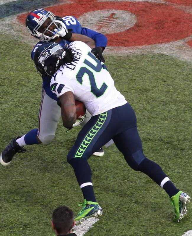 Seattle Seahawks running back Marshawn Lynch (24) is hit by New York Giants cornerback Prince Amukamara (20) during the first half of an NFL football game, Sunday, Dec. 15, 2013, in East Rutherford, N.J