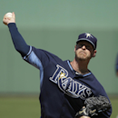 Tampa Bay Rays pitcher Mark Lowe delivers a warm-up throw in the third inning of an exhibition baseball game against the Boston Red Sox, Tuesday, March 4, 2014, in Fort Myers, Fla. The Rays beat the Red Sox 8-0 The Associated Press