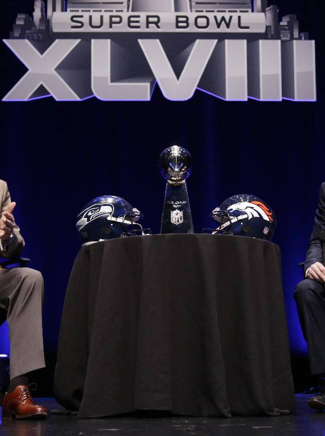 Seattle Seahawks head coach Pete Carroll and Denver Broncos head coach John Fox speak at a news conference Friday, Jan. 31, 2014, in New York. The Seahawks and the Broncos are scheduled to play in the NFL Super Bowl XLVIII football game on Sunday, Feb. 2, at MetLife Stadium in East Rutherford, N.J