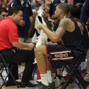 Arizona head coach Sean Miller, left, talks with his player as Brandon Ashley, right, towels off during the first half of the Arizona Red and Blue college basketball scrimmage at McKale Center in Tucson, Ariz., Sunday, Oct. 21, 2012. (AP Photo/Wily Low)