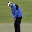 Kenny Perry sinks a birdie putt to go 10-under on the 15th hole during the third round of the Senior PGA Championship golf tournament at Bellerive Country Club, Saturday, May 25, 2013, in St. Louis. (AP Photo/Jeff Roberson)
