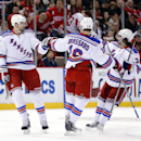New York Rangers left wing Rick Nash (61) celebrates his goal against the Detroit Red Wings with teammates Derick Brassard (16) and Mats Zuccarello (36) in the first period during an NHL hockey game in Detroit, Saturday, Dec. 6, 2014 The Associated Press