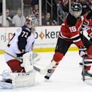 Columbus Blue Jackets goaltender Sergei Bobrovsky, left, of Russia, deflects a shot by New Jersey Devils' Travis Zajac during the second period of an NHL hockey game on Thursday, Feb. 27, 2014, in Newark, N.J The Associated Press