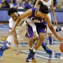LSU's Danielle Ballard, right, gets to a loose ball in front of Kentucky's A'dia Mathies during the first half of an NCAA college basketball game at Memorial Coliseum in Lexington, Ky., Sunday, Jan. 27, 2013. (AP Photo/James Crisp)