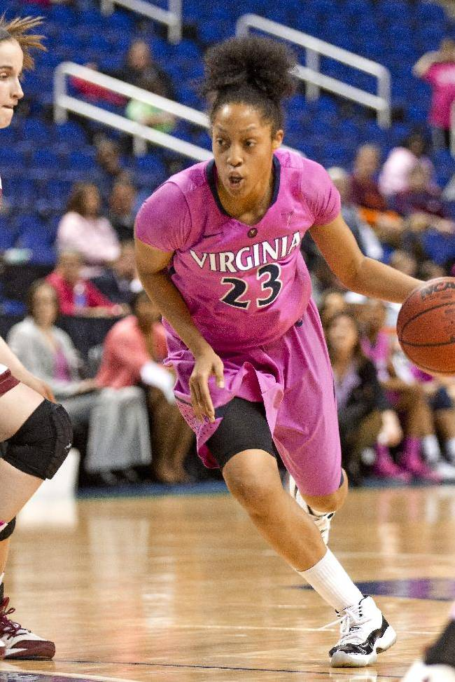 Virginia's Ataira Franklin drives the ball against Boston College's Kelly Hughes during an NCAA college basketball game at the Atlantic Coast Conference women's basketball tournament, Wednesday, March 5, 2014, in Greensboro, N.C