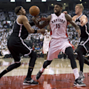 Toronto Raptors forward Amir Johnson (15) works between Brooklyn Nets forwards Paul Pierce, left, and Mason Plumlee during the first half of Game 2 in an NBA basketball first-round playoff series, Tuesday, April 22, 2014, in Toronto The Associated Press