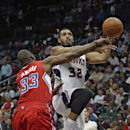 Atlanta Hawks power forward Mike Scott (32) is defended by Los Angeles Clippers power forward Antawn Jamison (33) as he goes up for a basket in the first half of an NBA basketball game Wednesday, Dec. 4, 2013, in Atlanta The Associated Press
