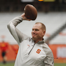 Syracuse's head coach Scott Shafer tosses a football before an NCAA college football game against Maryland at the Carrier Dome in Syracuse, N.Y., Saturday, Sept. 20, 2014 The Associated Press