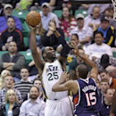 Utah Jazz's Al Jefferson (25) shoots as Atlanta Hawks' Al Horford (15) defends in the first quarter during an NBA basketball game Wednesday, Feb. 27, 2013, in Salt Lake City. (AP Photo/Rick Bowmer)