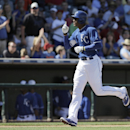 Kansas City Royals' Justin Maxwell celebrates as runs after hitting a home run during the fifth inning of a spring exhibition baseball game against the Texas Rangers, Saturday, March 22, 2014, in Surprise, Ariz The Associated Press