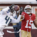 Seattle Seahawks cornerback Byron Maxwell, left, intercepts a pass intended for San Francisco 49ers wide receiver Michael Crabtree, right, in the second half of an NFL football game, Sunday, Dec. 8, 2013, in San Francisco The Associated Press