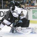 Los Angeles Kings center Anze Kopitar, of Slovenia, center, collides with San Jose Sharks goalie Antti Niemi, of Finland, bottom right, and defenseman Brad Stuart, left, during the secon period in Game 4 of their second-round NHL hockey Stanley Cup playoff series in San Jose, Calif., Tuesday, May 21, 2013. (AP Photo/Marcio Jose Sanchez)